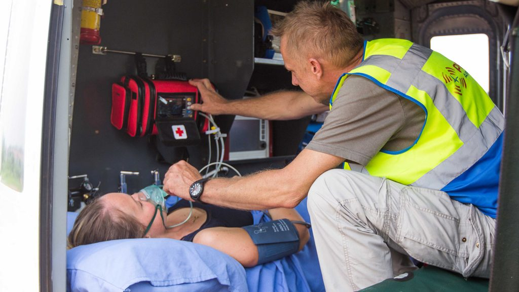 Paramedica administers oxygen to patient