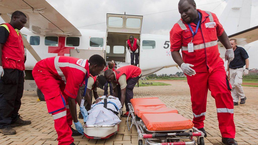 Paramedics transfer patient to air ambulance
